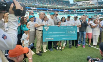 Dolphins and the DCC Give Check for $5.2 Million