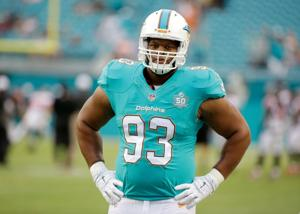 Dolphins restructure the contracts of Suh and Misi; Cut Greg Jennings